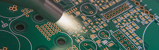 Blown-ion plasma treating equipment treats circuit board to improve surface adhesion.
